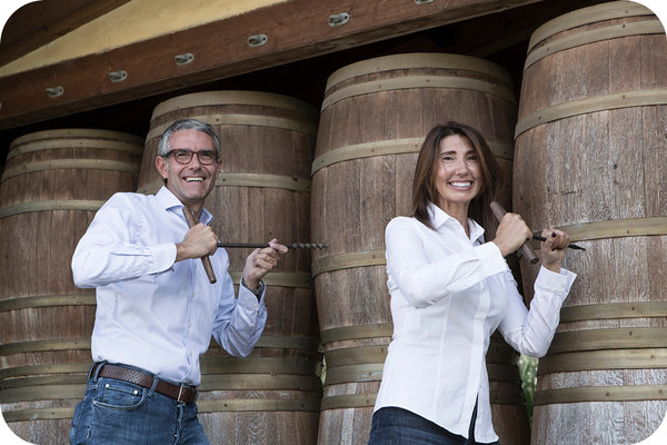 Sabrina and Marco Biscardo are drilling wine barrels - Cantina24.