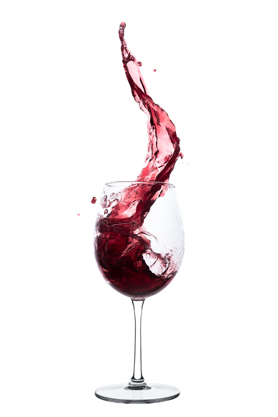 Image of a wine glass in which red wine is poured.
