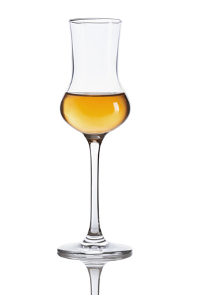 Grappa glass filled with grappa.